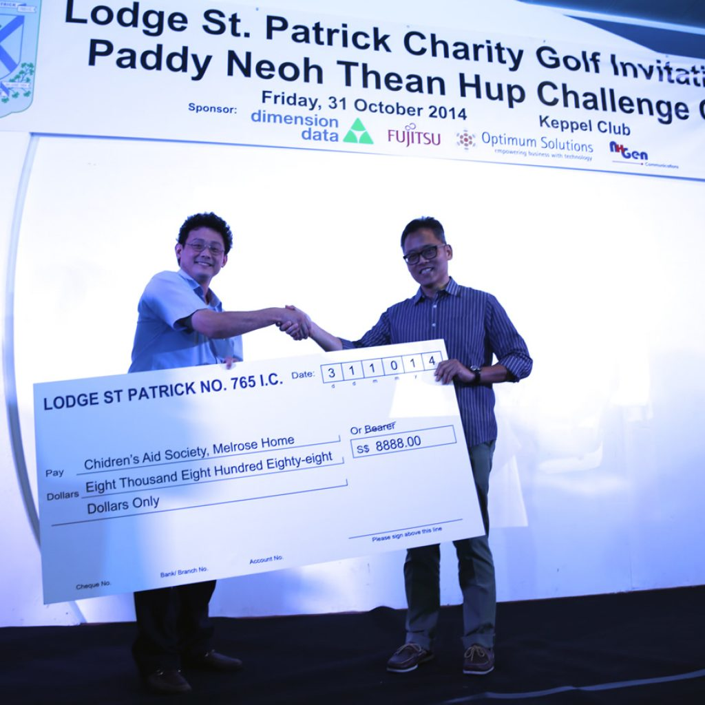 Cheque presentation to Mr Jeremy Khoo of the Children's Aid Society during the charity golf.